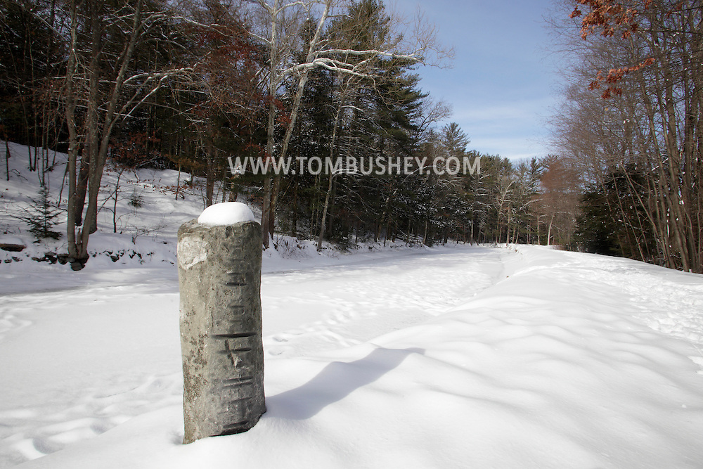 Cuddebackville, New York - A stone snubbing post alongside the frozen canal at the D&H Canal  Park  on Jan. 22, 2011. The grooves the rock were made by ropes from the barges in the canal.