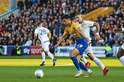 Tyler Walker (19) clears the ball during the EFL Sky Bet League 2 second leg Play Off match between Mansfield Town and Newport County at the One Call Stadium, Mansfield, England on 12 May 2019.