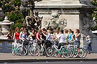bike tour on Pont Alexandre III Paris France in Spring time of May 2008