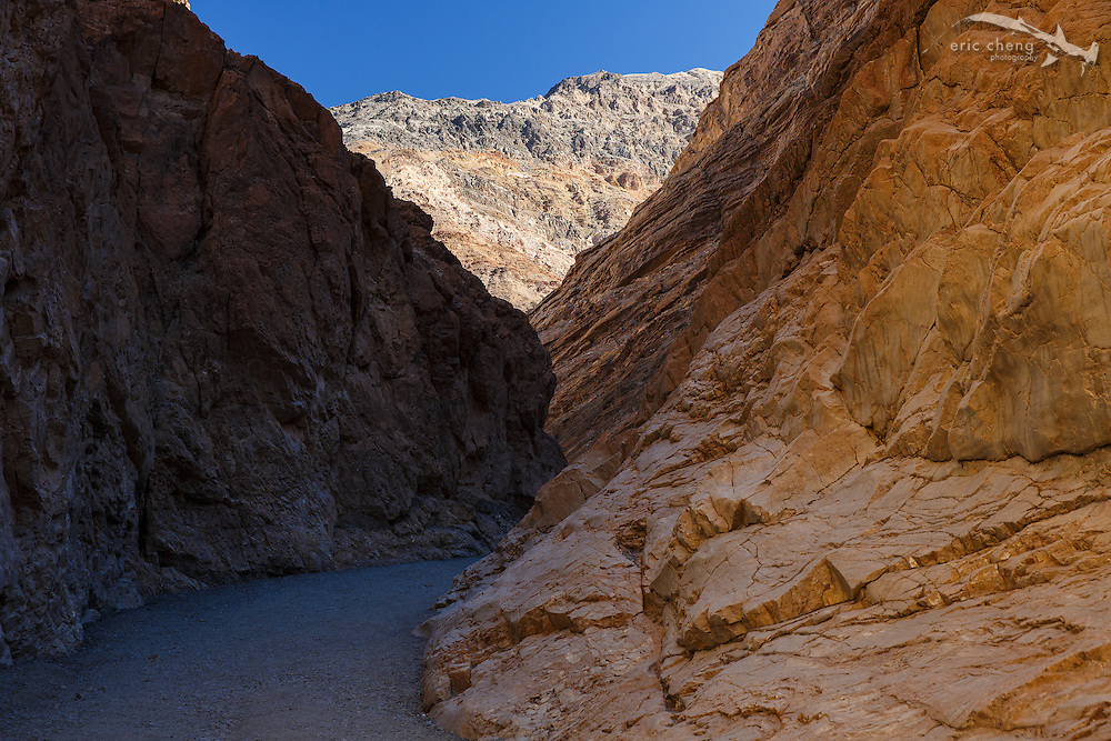 Mosaic Canyon in Death Valley features impressive geological formations, including a slot canyon that zig zags for a bit before opening up into a much wider space.