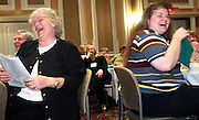 18388.Joann Wiblin of CTEC of Licking County, left, and Laura Evans of the Pickaway-Ross ABLE program burst with laughter while Dr. Bertice Berry speaks at the Literacy Kickoff on Friday, September 14, 2007 in Athens, Ohio. Also enjoying the speech, from left, are Michael Johnston of CTEC of Licking County, Mary Lee Humphrey of Marietta City Schools and Kitty Brewer of the Pickaway-Ross ABLE program. (Photo by Kevin Riddell)