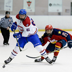 KINGSTON, ON  - FEB 22,  2018: Ontario Junior Hockey League game between the Kingston Voyageurs and the Wellington Dukes. Aidan McFarland #81 of the Kingston Voyageurs skates with the puck while being pursued by Dawson Ellis #21 of the Wellington Dukes during the first period.<br /> (Photo by Ian Dixon / OJHL Images)
