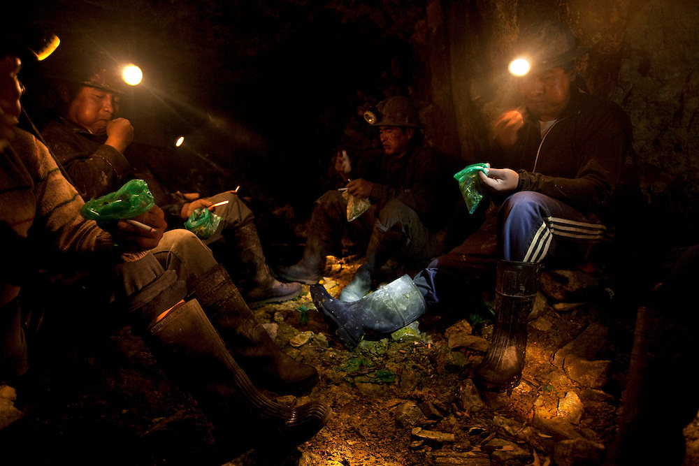 Miners chew coca and pay their respects to the uncle of the mine.  The offerings include coca leaves, alcohol, tobacco and llama or sheep sacrifices.