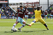 Burnley defender Matthew Lowton (2)  with a shot during the Sky Bet Championship match between Burnley and Leeds United at Turf Moor, Burnley, England on 9 April 2016. Photo by Simon Davies.