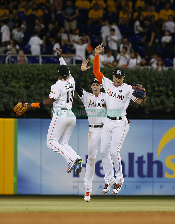 June 21, 2017 - Miami, FL, USA - Miami Marlins players Marcell Ozuna, Christian Yelich and Giancarlo Stanton celebrate after a 2-1 win over the Washington Nationals on Wednesday, June 21, 2017 at Marlins Park in Miami, Fla. (Credit Image: © David Santiago/TNS via ZUMA Wire)