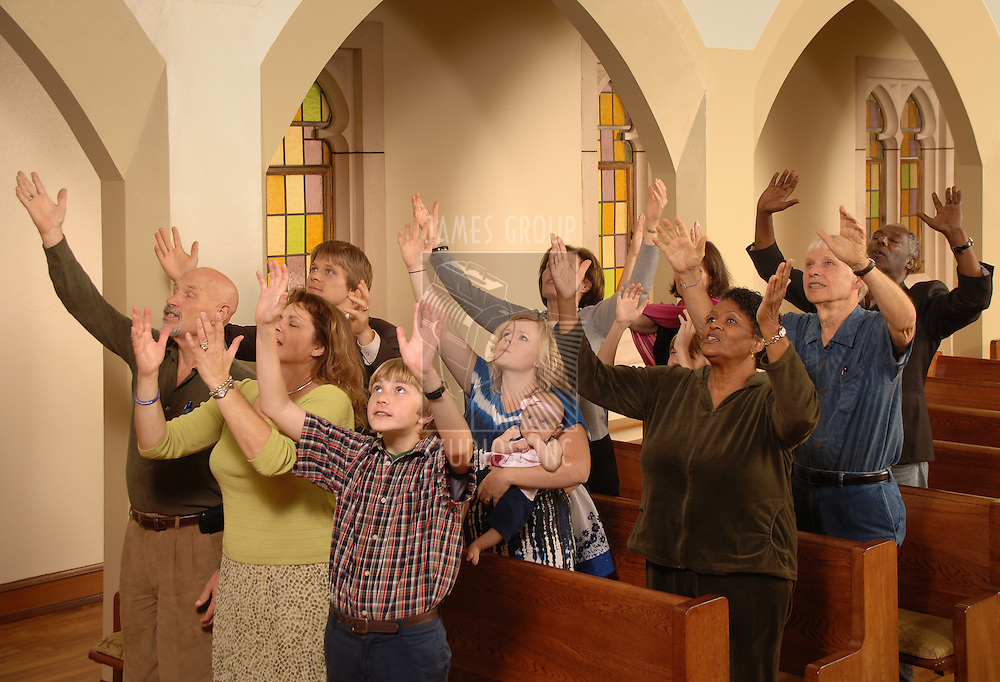 Congregation lifting hands in worship