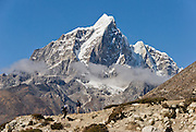 Taboche Peak (20,880 feet / 6367 meters elevation), in the Khumbu District of Nepal, part of the Himalaya Mountain Range in High Asia. Sagarmatha National Park was created in 1976 and honored as a UNESCO World Heritage Site in 1979.