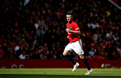 Manchester United Legends player David Beckham in action during the legends match against at Old Trafford, Manchester.