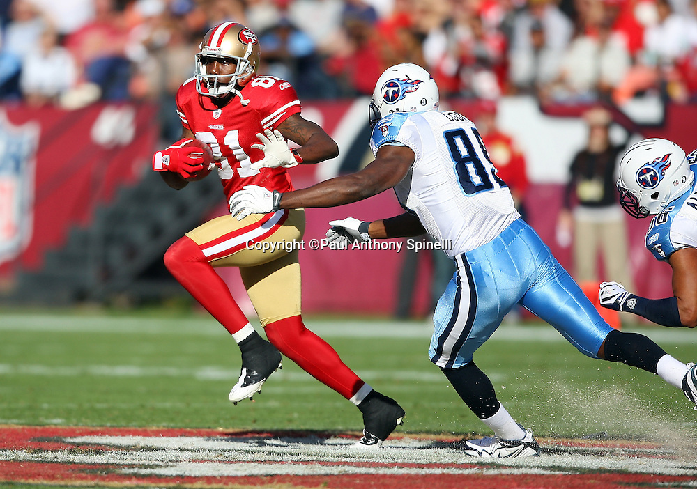 San Francisco 49ers punt returner Brandon Jones (81) gets chased and tackled by Tennessee Titans tight end Jared Cook during the NFL football game against the Tennessee Titans, November 8, 2009 in San Francisco, California. The Titans won the game 34-27. (©Paul Anthony Spinelli)