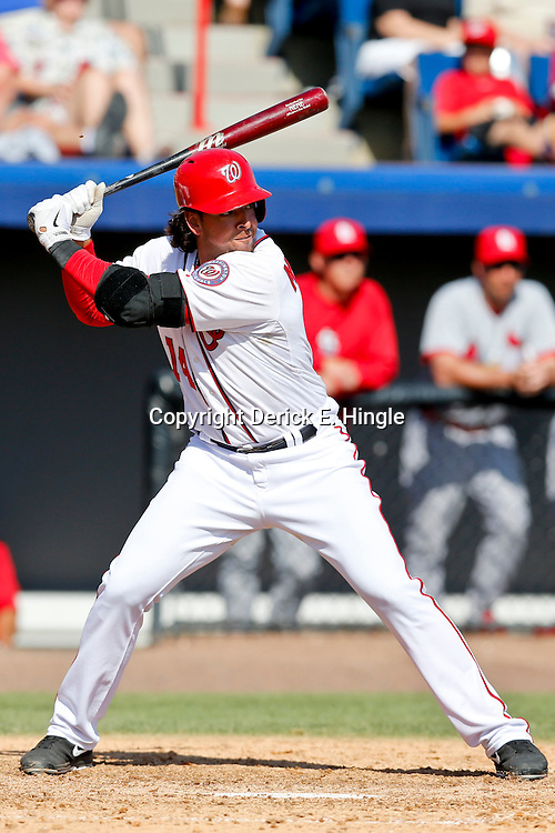Mar 8, 2013; Melbourne, FL, USA; Washington Nationals first baseman Chris Marrero (14) against the St. Louis Cardinals during a spring training game at Space Coast Stadium. Mandatory Credit: Derick E. Hingle-USA TODAY Sports