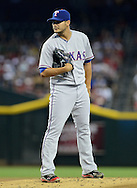 PHOENIX, AZ - MAY 27:  Pitcher Martin Perez #33 of the Texas Rangers pitches against the Arizona Diamondbacks during an interleague game at Chase Field on May 27, 2013 in Phoenix, Arizona.  (Photo by Jennifer Stewart/Getty Images) *** Local Caption *** Martin Perez