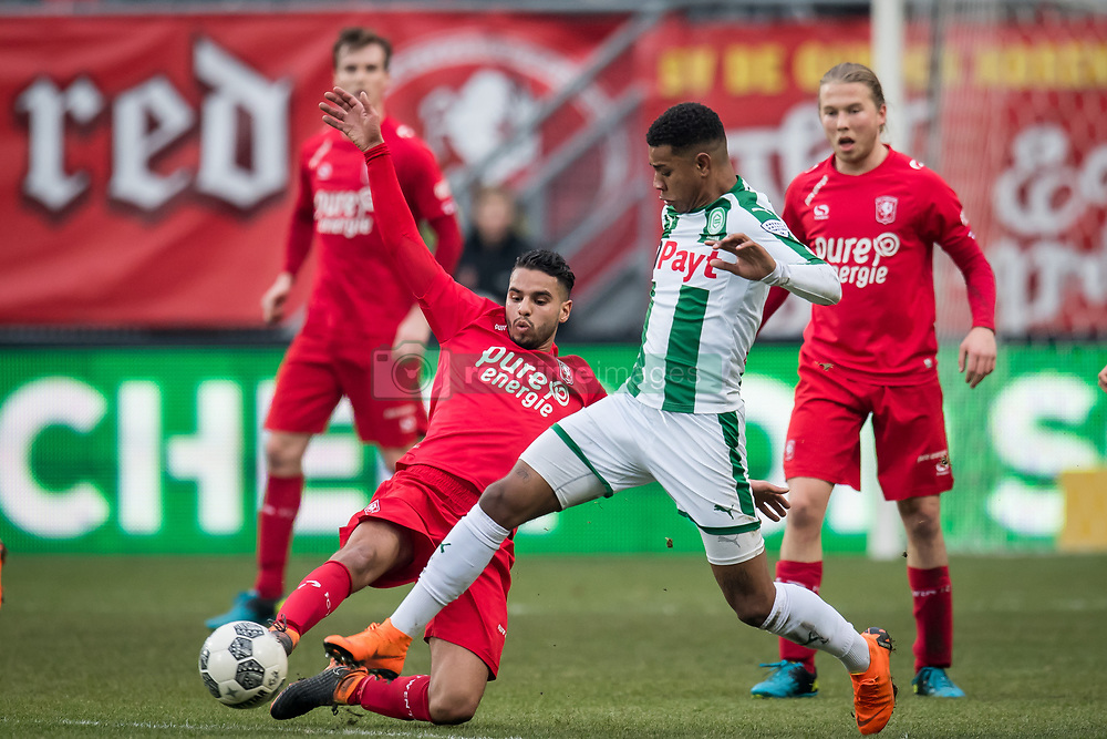(L-R) Adam Maher of FC Twente, Juninho Bacuna of FC Groningen during the Dutch Eredivisie match between FC Twente Enschede and FC Groningen at the Grolsch Veste on March 04, 2018 in Enschede, The Netherlands