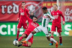 (L-R) Adam Maher of FC Twente, Juninho Bacuna of FC Groningen during the Dutch Eredivisie match between FC Twente Enschede and FC Groningen at the Grolsch Veste on March 04, 2018 in Enschede, The Netherlands