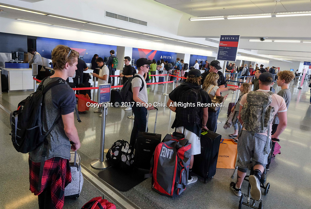 Holiday travelers crowd check in at Los Angeles International Airport on Friday, June 30, 2017 in Los Angeles.(Photo by Ringo Chiu)<br /> <br /> Usage Notes: This content is intended for editorial use only. For other uses, additional clearances may be required.