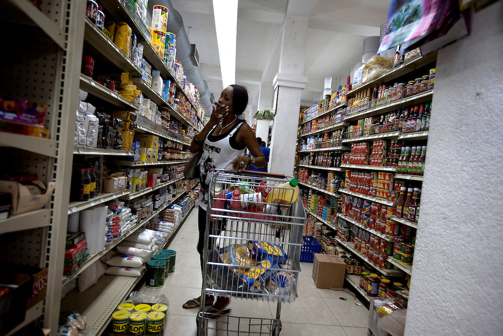 A woman looking for food in a supermarket in Port-au-Prince, Haiti on July 15, 2010. <br /> Six month after a catastrophic earthquake measuring 7.3 on the Richter scale hit Haiti on January 13, 2010, killing an estimated 230,000 people, injuring an estimated 300,000 and making homeless an estimated 1,000,000.