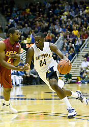 January 9, 2010; Berkeley, CA, USA;  California Golden Bears forward Theo Robertson (24) dribbles past Southern California Trojans forward Marcus Johnson (0) during the first half at the Haas Pavilion.  California defeated USC 67-59.
