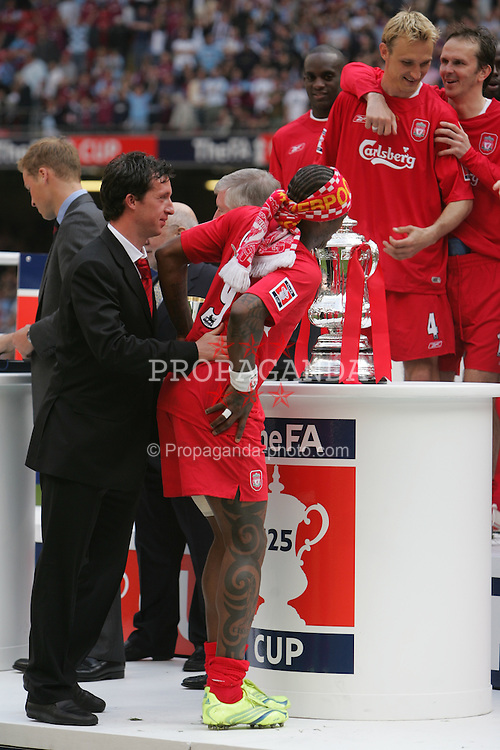 CARDIFF, WALES - SATURDAY, MAY 13th, 2006: Liverpool's Djibril Cisse kisses the cup after winning the FA Cup Final on penalties beating West Ham United at the Millennium Stadium. (Pic by David Davies/Pool/Propaganda)