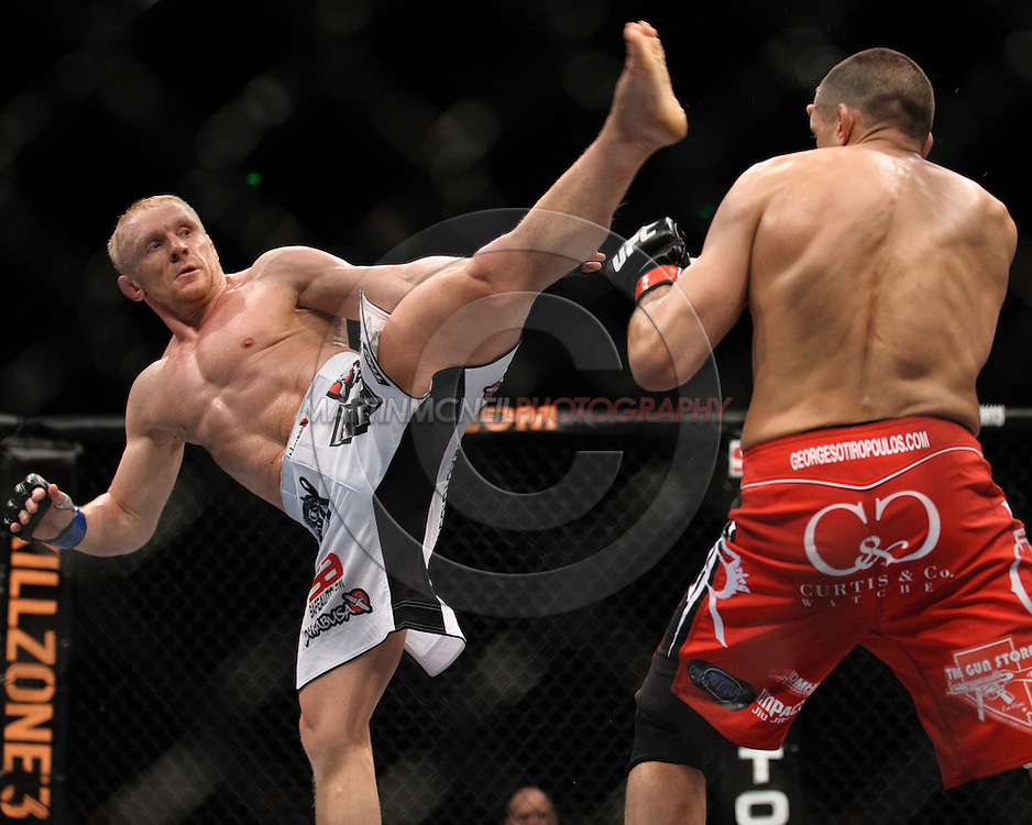 "SYDNEY, AUSTRALIA, FEBRUARY 27, 2011: Dennis Siver (left) thows a kick towards George Sotiropoulos during ""UFC 127: Penn vs. Fitch"" inside Acer Arena in Sydney, Australia on February 27, 2011."