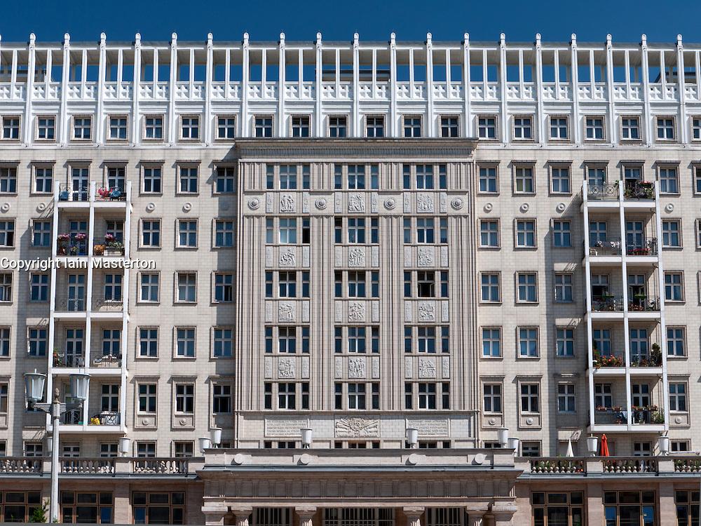 Facades of old socialist GDR era apartment buildings on Karl Marx Allee in former East Berlin Germany