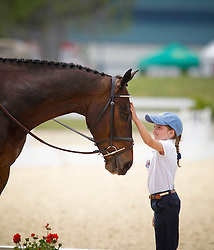 Young fan pats Mandiba of Karen O Connor as he comes out of the dressage arena<br /> Rolex Kentucky Three Day Event CCI4<br /> © Hippo Foto - Cealy Tetly
