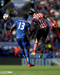 Shane Long of Southampton wins a header against Daniel Amartey of Leicester City - Mandatory by-line: Robbie Stephenson/JMP - 02/10/2016 - FOOTBALL - King Power Stadium - Leicester, England - Leicester City v Southampton - Premier League