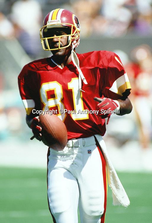 Washington Redskins wide receiver Art Monk (81) looks on after catching a pass during the NFL football game against the Arizona Cardinals on Oct. 4, 1992 in Tempe, Arizona. The Cardinals won the game 27-24. (©Paul Anthony Spinelli)