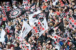 Saracens fans waving flags. The Guinness Premiership final 2010 between Leicester Tigers and Saracens at Twickenham Stadium, London, England. May 29th, 2010. .