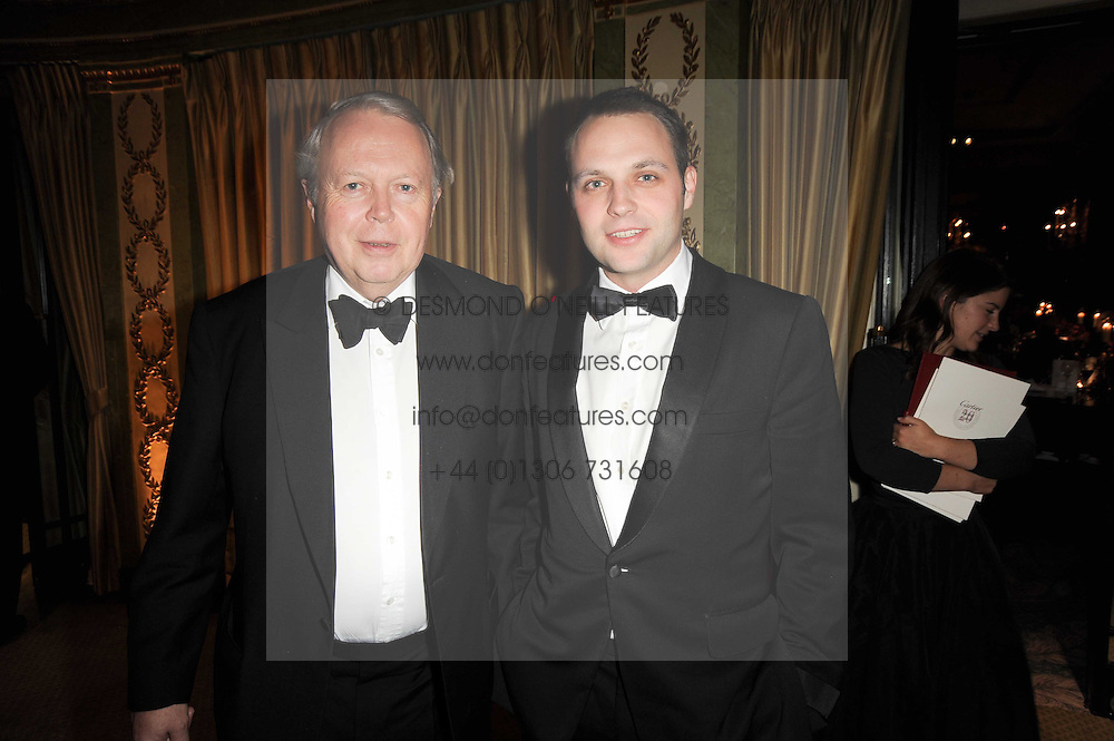 Left to right, the EARL DE LA WARR and his son the HON.EDWARD SACKVILLE at the 20th annual Cartier Racing Awards - the most prestigious award ceremony within European horseracing, held at The Dorchester Hotel, Park Lane, London on 16th November 2010.