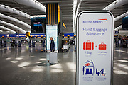 British Airways' Hand Baggage Allowance sign helping passengers check-in at Heathrow Airport's Terminal 5.