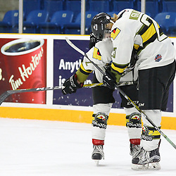 TRENTON, ON  - MAY 5,  2017: Canadian Junior Hockey League, Central Canadian Jr. &quot;A&quot; Championship. The Dudley Hewitt Cup Game 7 between Georgetown Raiders and the Powassan Voodoos.    Tyson Gilmour #23 hugs  Justin Schebel #2 of the Powassan Voodoos post game.<br /> (Photo by Alex D'Addese / OJHL Images)