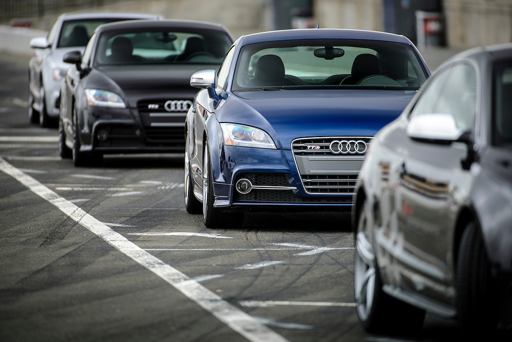 Row of Audi cars in pit lane. Sonoma Raceway | Audi sportscar experience