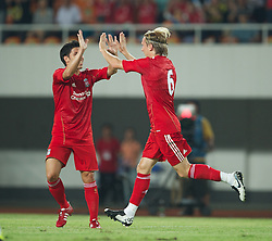 GUANGZHOU, CHINA - Wednesday, July 13, 2011: Liverpool's Christian Poulsen celebrates scoring the first goal against Guangdong Sunray Cave during the first pre-season friendly on day three of the club's Asia Tour at the Tianhe Stadium. (Photo by David Rawcliffe/Propaganda)