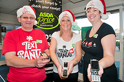 Text Santa  Charity Campaign Launch People Manager Sue Stringer with Asda collueuages John Somerville (left) and Jess Langan (right) Barrow Road Asda Harrogate. .www.pauldaviddrabble.co.uk.6 December 2011  Image © Paul David Drabble