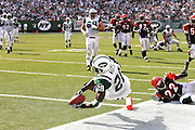 EAST RUTHERFORD, NJ - SEPTEMBER 12:  Running back Curtis Martin #28 of the New York Jets catches the winning touchdown pass against the Cincinnati Bengals at Giants Stadium on September 12, 2004 in East Rutherford, New Jersey. The Jets defeated the Bengals 31-24. ©Paul Anthony Spinelli *** Local Caption *** Curtis Martin