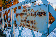 "The sign on the Cambus o' May Bridge which crosses the River Dee in Scotland; ""Opened by Her Majesty Queen Elizabeth, The Queen Mother, 23rd September 1988""."