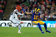 Cincinnati Bengals Defensive Back Tony McRae (29) tackles LA Rams Wide Receiver Cooper Kupp (18) during the International Series match between Los Angeles Rams and Cincinnati Bengals at Wembley Stadium, London, England on 27 October 2019.