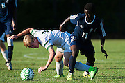 Rice's Nate Cary (9) and Burlington's Seraphin Iradukunda (11) battle for the ball during the boys soccer game between the The Burlington Seahorses and the Rice Green Knights at Rice Memorial high School on Tuesday afternoon September 15, 2015 in South Burlington, Vermont. (BRIAN JENKINS/for the FREE PRESS)