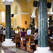 A Sunday morning church service in the historic Guadalupe Church (Iglesia de Guadalupe) in Granada, Nicaragua.