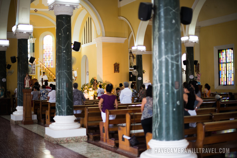 A Sunday morning church service in the historic Guadalupe Church (Iglesia de Guadalupe) in Granada, Nicaragua.