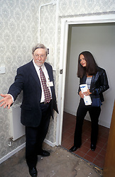 Council housing officer showing prospective tenant new flat, London UK