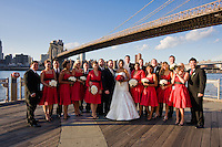 A wedding being photographed in Brooklyn with New York City behind in October 2008