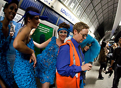 © licensed to London News Pictures. London, UK  08/06/2011. 19 models wearing turquoise dresses designed by Pierre Garroudi hit Central London and London Underground (Jubilee Line) in a flashmob today, Wed. 8 June. Underground staff at London Bridge try to stop the flashmob and photographers.  Please see special instructions for usage rates. Photo credit should read Bettina Strenske/LNP
