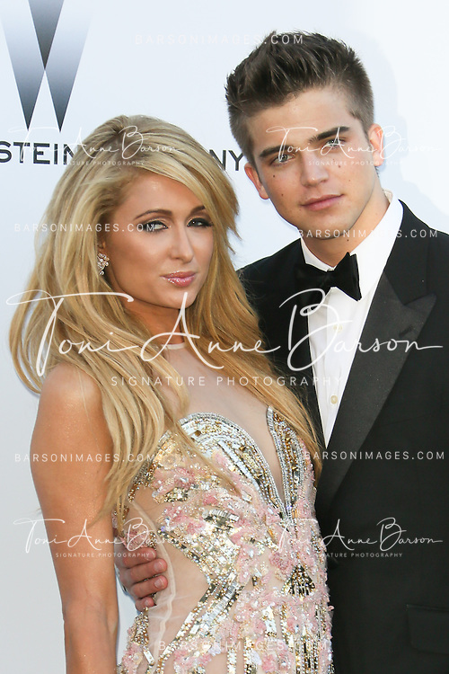 CAP D'ANTIBES, FRANCE - MAY 23:  Paris Hilton and River Viiperi arrive at amfAR's 20th Annual Cinema Against AIDS at Hotel du Cap-Eden-Roc on May 23, 2013 in Cap d'Antibes, France.  (Photo by Tony Barson/FilmMagic,)