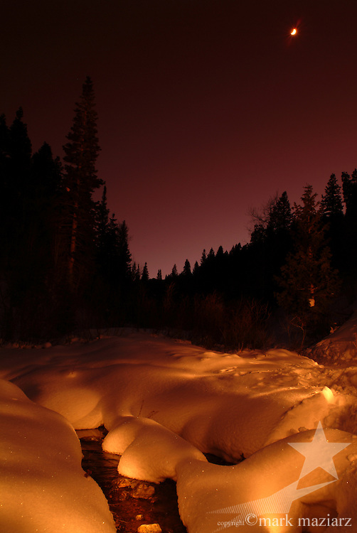 snowy stream in valley