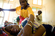 His aunt checks on Issoufou Abdoul Wahab, 17, at the Aguie district hospital in the town of Aguie, roughly 80 km east of Maradi, Niger on Friday April 17, 2009. Issoufou was in coma for three days after being infected with meningitis. He's now on his way to recovery, but is suffering partial loss of hearing - an effect of meningitis that may go away, or not.