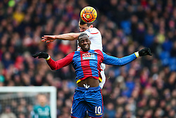 Dejan Lovren of Liverpool heads the ball over Yannick Bolasie of Crystal Palace - Mandatory byline: Jason Brown/JMP - 07966386802 - 06/03/2016 - FOOTBALL - London - Selhurst Park - Crystal Palace v Liverpool - Barclays Premier League