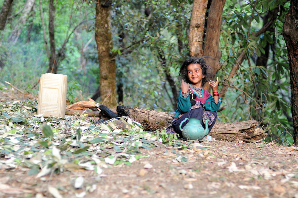 Salma, 5 years old, washes up along a forest trail one morning.