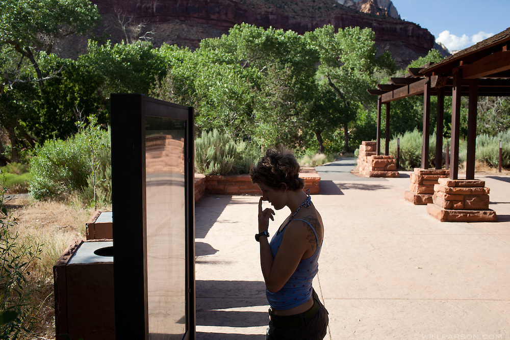Liz checks the ranger talk schedule near the visitor's center at Zion National Park in Utah.