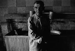 An old man stands in bath-room in barrack where he lives in house for  released an old prisoners in village Blagoveshenka, Kemerovo region, Eastern Siberia, Russia, 15 August 1995. Blagoveshensky house for an old former prisoners a special institution which is a part of a penitentiary system where live former prisoners which after released have age more then 55 years and haven't house or an apartment and relatives.