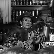 Margarita Lopez vda de Villa Fuerte, 80, seller,  Potosi. Bolivia..Sitting at 4,090M (13,420 Feet) above sea level the small mining community of Potosi, Bolivia is one of the highest cities in the world by elevation and sits ?sky high? in the hills of the land locked nation. Overlooking the city is the infamous mountain, Cerro Rico (rich mountain), a mountain conceived to be made of silver ore. It was the major supplier of silver for the spanish empire and has been mined since 1546, according to records 45,000 tons of pure silver were mined from Cerro Rico between 1556 and 1783, 9000 tons of which went to the Spanish Monarchy. The mountain produced fabulous wealth and became one of the largest and wealthiest cities in Latin America. The Extraordinary riches of Potosi were featured in Maguel de Cervantes famous novel Don Quixote. One theory holds that the mint mark of Potosi, the letters PTSI superimposed on one another is the origin of the dollar sign. Today mainly zinc, lead, tin and small quantities of silver are extracted from the mine by over 100 co-operatives and private mining companies who still mine the mountain in poor working conditions, children are still used in the mines and the lack of protective equipment and constant inhalation of dust means miners have a short life expectancy with many contracting silicosis and dying around 40 years of age. UNESCO designated the historic city a World Heritage site in 1987. Most of Potosí's colonial churches have been restored, and tourism has increased. Potosi, Bolivia. 16th September 2011. Photo Tim Clayton